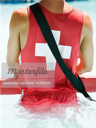 lifeguard at a waterpark Stock Photo - Premium Royalty-Free, Image code: 640-02951731