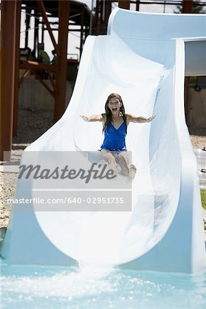 woman on a water slide Stock Photo - Premium Royalty-Free, Image code: 640-02951735