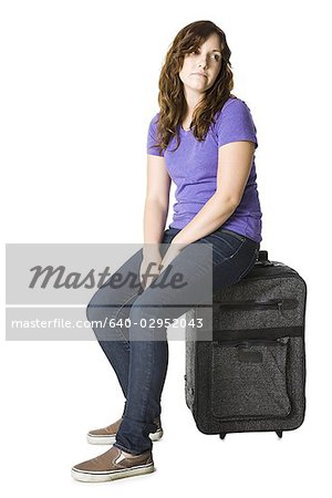 woman with a suitcase Stock Photo - Premium Royalty-Free, Image code: 640-02952043