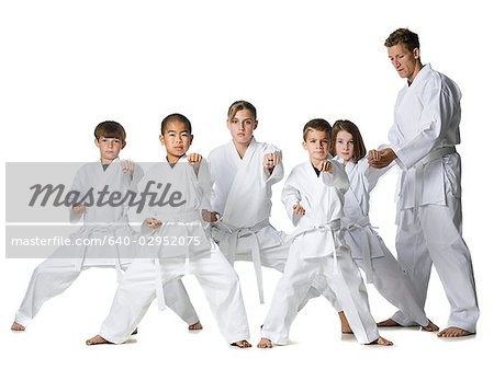 youth practicing martial arts Stock Photo - Premium Royalty-Free, Image code: 640-02952075