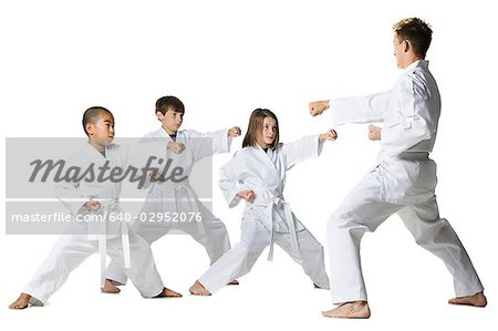 youth practicing martial arts Stock Photo - Premium Royalty-Free, Image code: 640-02952076