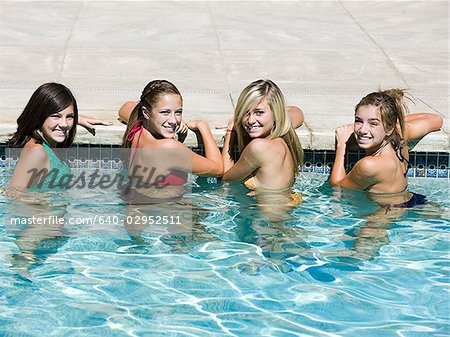 teenagers in a swimming pool Stock Photo - Premium Royalty-Free, Image code: 640-02952511