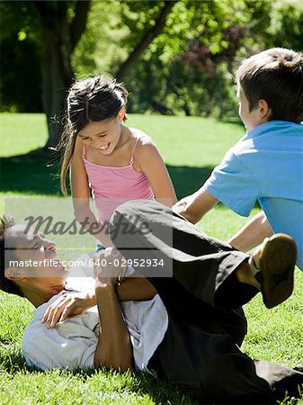 dad in the park with his two kids Stock Photo - Premium Royalty-Free, Image code: 640-02952934