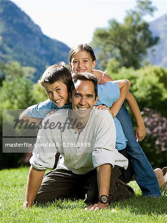 dad in the park with his two kids Stock Photo - Premium Royalty-Free, Image code: 640-02952939