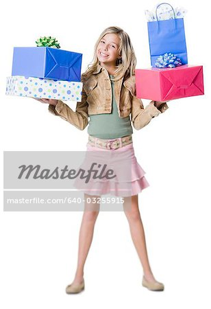 Girl with shopping bags Stock Photo - Premium Royalty-Free, Image code: 640-03255915