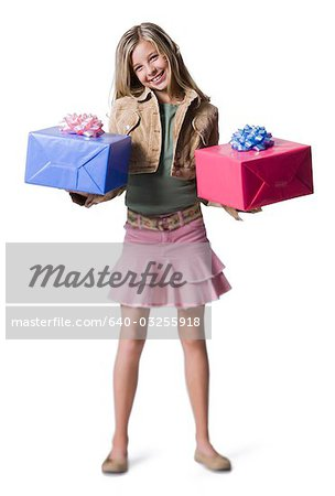 Girl with shopping bags Stock Photo - Premium Royalty-Free, Image code: 640-03255918