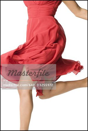 Woman in red dress dancing Stock Photo - Premium Royalty-Free, Image code: 640-03255972