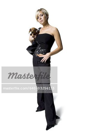 Woman with a small dog in her purse Stock Photo - Premium Royalty-Free, Image code: 640-03256133