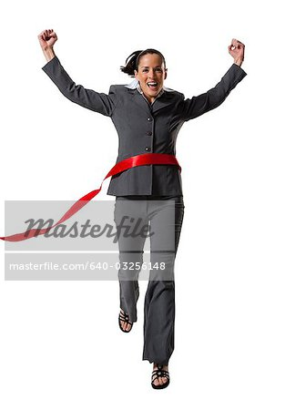 Businesswoman crossing finish line Stock Photo - Premium Royalty-Free, Image code: 640-03256148
