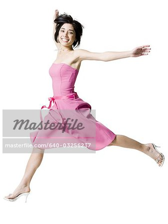 Woman jumping with high heels Stock Photo - Premium Royalty-Free, Image code: 640-03256237