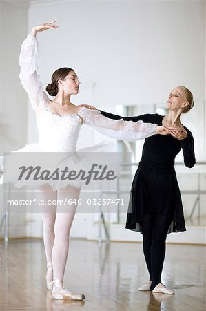 Springville, Utah, USA, Ballet teacher and young ballet dancer (16-17) Stock Photo - Premium Royalty-Free, Image code: 640-03257471
