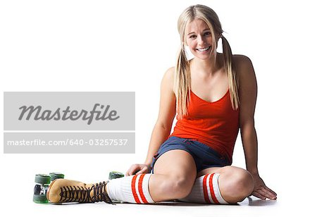 Portrait of young woman wearing roller skates Stock Photo - Premium Royalty-Free, Image code: 640-03257537