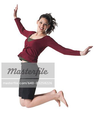 Person leaping in the air Stock Photo - Premium Royalty-Free, Image code: 640-03258226