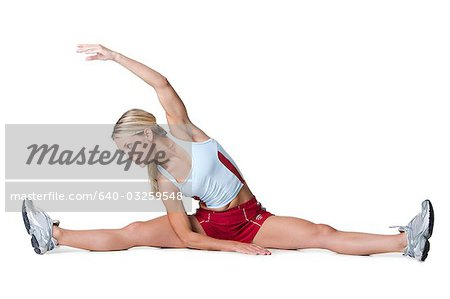 Woman stretching Stock Photo - Premium Royalty-Free, Image code: 640-03259548
