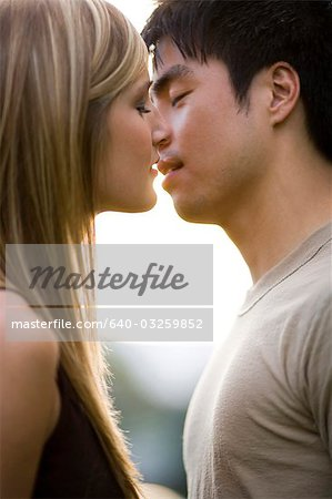 Young couple about to kiss Stock Photo - Premium Royalty-Free, Image code: 640-03259852