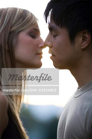 Young couple about to kiss Stock Photo - Premium Royalty-Free, Image code: 640-03259853