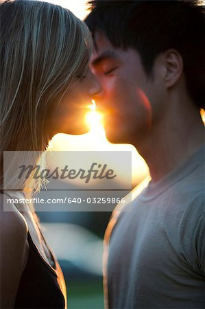 Young couple about to kiss Stock Photo - Premium Royalty-Free, Image code: 640-03259866