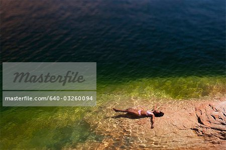 Woman lying in the water on back Stock Photo - Premium Royalty-Free, Image code: 640-03260094