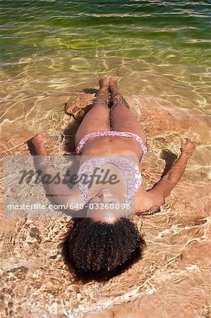 Woman lying in the water on her back Stock Photo - Premium Royalty-Free, Image code: 640-03260096