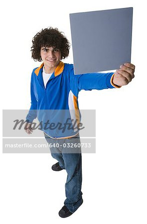 Man holding a blank sign Stock Photo - Premium Royalty-Free, Image code: 640-03260733