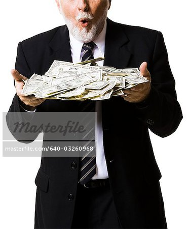 Portrait of businessman holding money bag Stock Photo - Premium Royalty-Free, Image code: 640-03260968