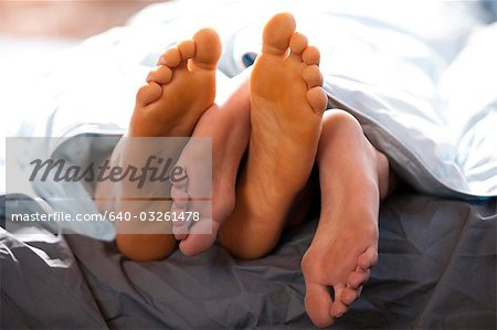 Four feet under blankets Stock Photo - Premium Royalty-Free, Image code: 640-03261478