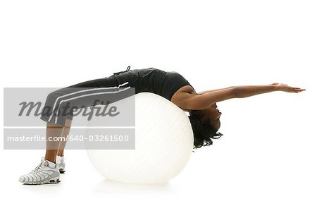 Woman stretching on pilates ball Stock Photo - Premium Royalty-Free, Image code: 640-03261500