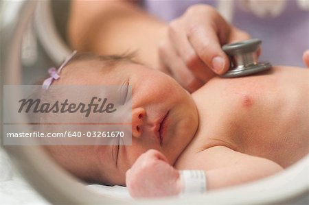 Woman holding baby's hand Stock Photo - Premium Royalty-Free, Image code: 640-03261670