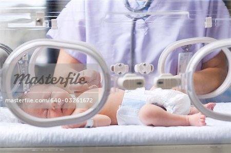 Woman holding baby's hand Stock Photo - Premium Royalty-Free, Image code: 640-03261672