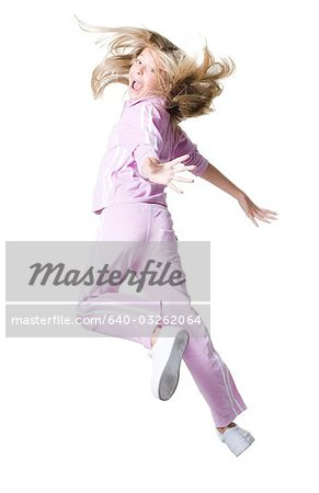 Portrait of a girl leaping Stock Photo - Premium Royalty-Free, Image code: 640-03262064