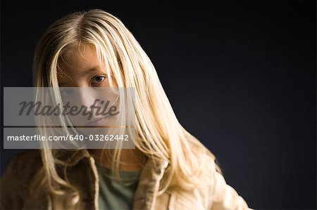 Closeup of girl with blonde hair Stock Photo - Premium Royalty-Free, Image code: 640-03262442