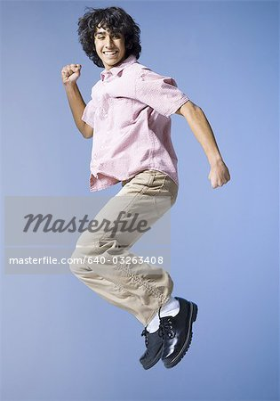 Boy jumping Stock Photo - Premium Royalty-Free, Image code: 640-03263408