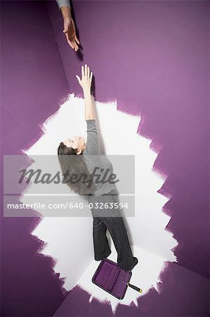Woman reaching for a helping hand Stock Photo - Premium Royalty-Free, Image code: 640-03263594
