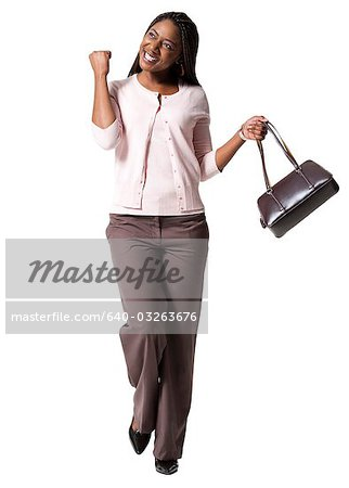 Excited woman walking Stock Photo - Premium Royalty-Free, Image code: 640-03263676