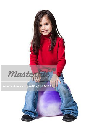 Girl with a big ball Stock Photo - Premium Royalty-Free, Image code: 640-03264162