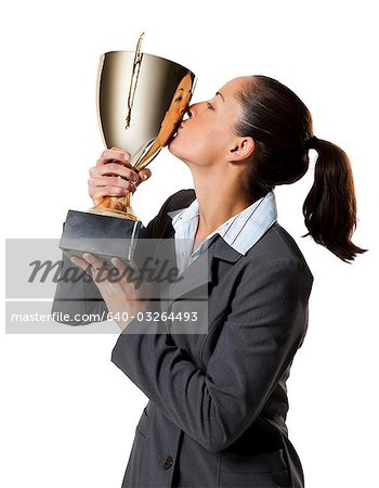 Woman holding trophy Stock Photo - Premium Royalty-Free, Image code: 640-03264493