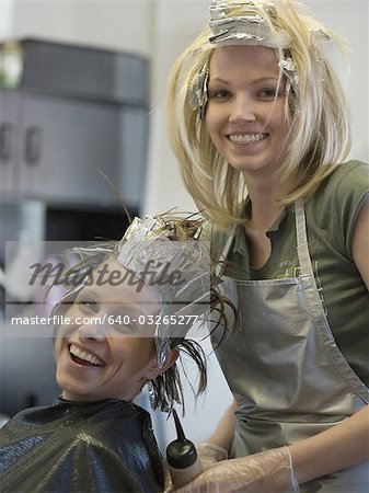 Portrait of two women in a beauty salon Stock Photo - Premium Royalty-Free, Image code: 640-03265277