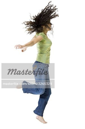 Woman dancing and shaking her hair Stock Photo - Premium Royalty-Free, Image code: 640-03265328