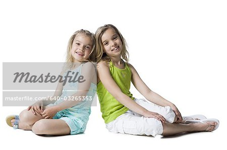 Young sisters posing Stock Photo - Premium Royalty-Free, Image code: 640-03265353