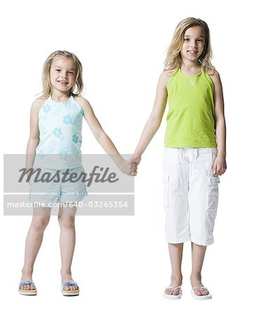 Young sisters posing Stock Photo - Premium Royalty-Free, Image code: 640-03265354