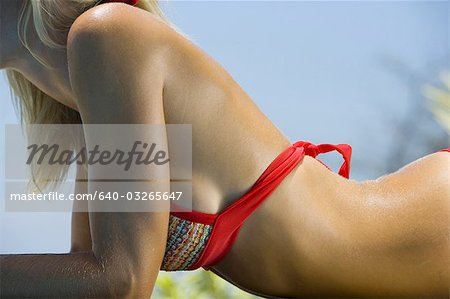 Mid section view of a adult woman sunbathing Stock Photo - Premium Royalty-Free, Image code: 640-03265647