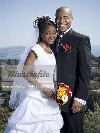 Portrait of a newlywed couple smiling together Stock Photo - Premium Royalty-Free, Image code: 640-03265670