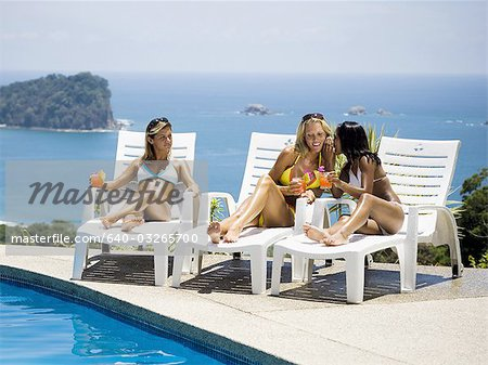 Three women relaxing on deck loungers Stock Photo - Premium Royalty-Free, Image code: 640-03265700