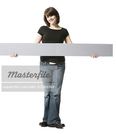 Girl holding blank sign Stock Photo - Premium Royalty-Free, Image code: 640-03265769