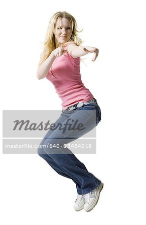 Young woman jumping Stock Photo - Premium Royalty-Free, Image code: 640-03434018