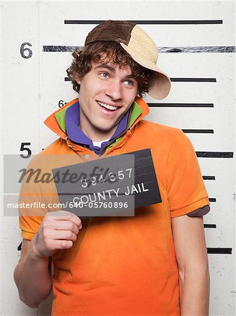 Studio mugshot of young man Stock Photo - Premium Royalty-Free, Image code: 640-05760896