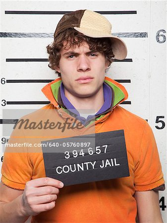 Studio mugshot of young man Stock Photo - Premium Royalty-Free, Image code: 640-05760897