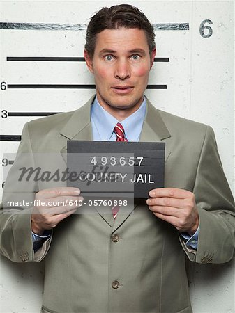 Studio mugshot of businessman Stock Photo - Premium Royalty-Free, Image code: 640-05760898