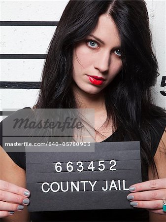 Studio mugshot of young woman Stock Photo - Premium Royalty-Free, Image code: 640-05760903