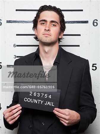 Studio mugshot of young man Stock Photo - Premium Royalty-Free, Image code: 640-05760906